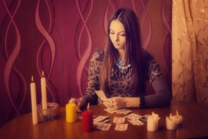 71067075 - young woman with divination cards in room